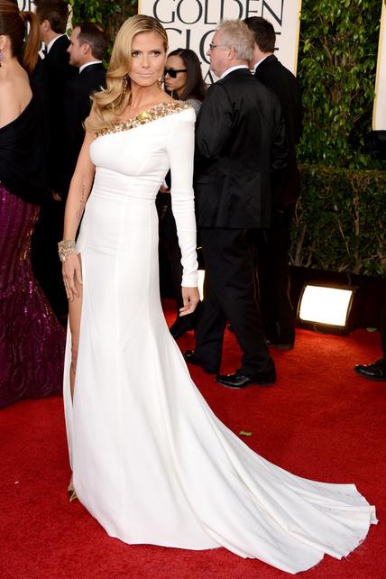 GUAU. A Heidi Klum le perdono lo de la pierna. Por su pelazo. Por su tipazo. Porque la adoro.