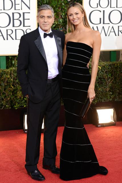 Yo con ese traje sería una morcilla encebollada, pero a la señorita Clooney le queda como un guante.