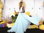 """AMOR por el vestidazo """"azul Nairobi"""" de la triunfadora Lupita Nyong'o. FAN."""